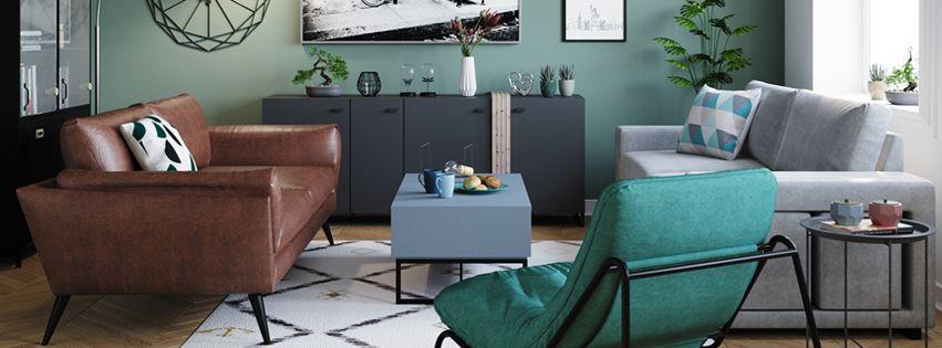 Salon Conforama avec deux canapés gris et marron et un fauteuil bleu, avec des tapis au motif géométrique